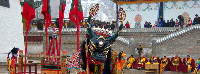 A masked dancer performs a ceremonial ritual at a monastery in Amdo