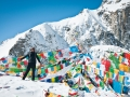 one-of-our-client-poses-for-a-photo-on-the-dolma-la-pass-during-mt-kailash-kora