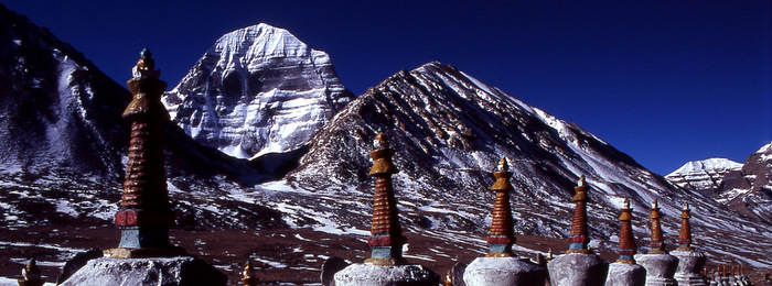 White stupas in front of Mt. Kailash